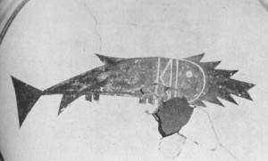 A Mimbres Indian ceramic that has a catfish depicted with the Libyan word of catfish drawn on it.